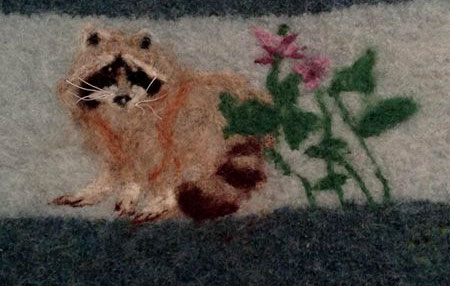 Needle Felted Racoon - surface detail on knitted purse