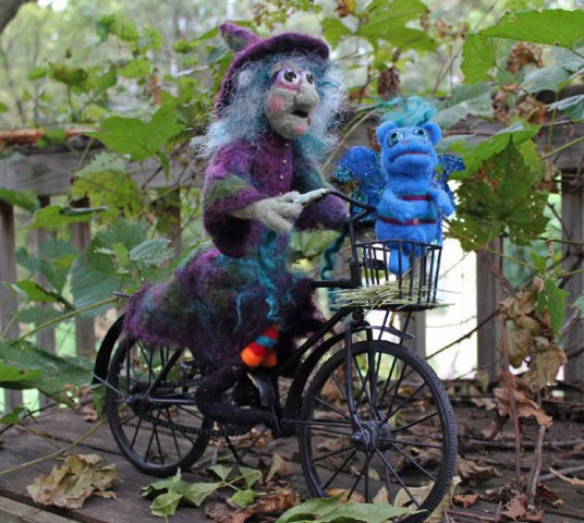 needle felted witch riding bicycle