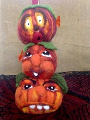 needle felted pumpkins with faces