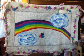 Felted rainbow Quilt with clouds and hearts
