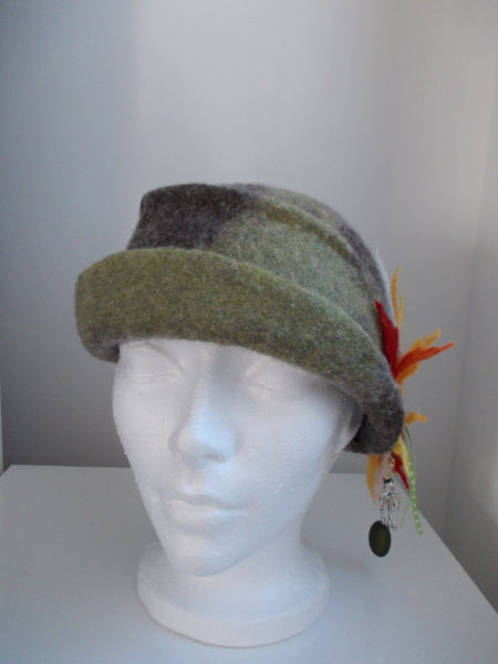 brown and green needle and wet felted hat