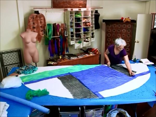 Joni Cornell of Wrapt in Felt layout out silks for her nuno felt shawl