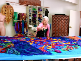Joni Cornell of Wrapt in Felt wets out her nuno felt shawl