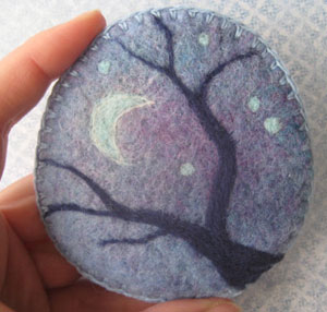 felted brooch with tree and moon