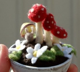 Needle Felted Fairy Garden by Kimberly Czar featured on www.livingfelt.com/blog