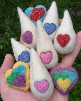 Needle Felted Milk Drop Hearts by Jessie Dockins featured on www.livingfelt.com/blog