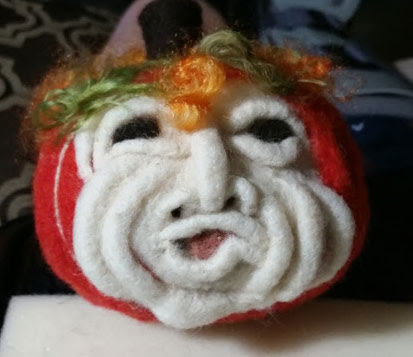 Needle Felted Funny Face Pumpkin by Susan Huff featured on www.livingfelt.com/blog.