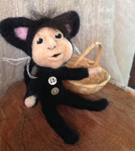 Needle Felted Trick or Treater by Joyce Hazlerig featured on www.livingfelt.com/blog.
