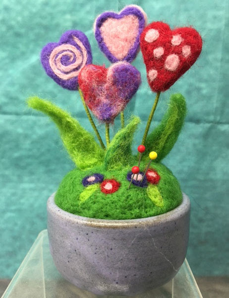 Needle Felted Pincushion by JoAnn Stratakos featured on www.livingfelt.com/blog