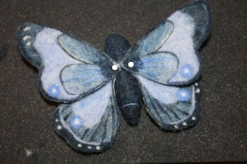 Needle Felted Butterfly by Marie Spaulding featured on www.livingfelt.com/blog.