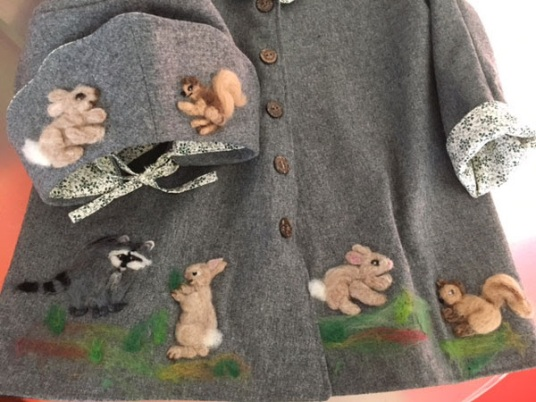 Needle Felted Wool Coat with Bunnies by Susan Nelson featured on www.livingfelt.com/blog